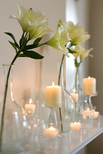 Candles and white flowers.