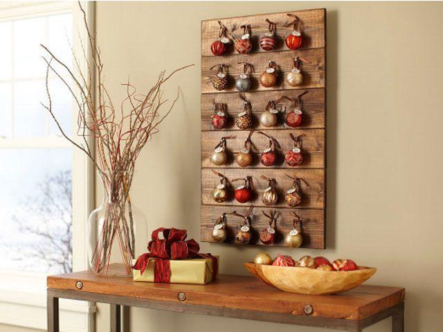 Использование мелиорированных древесины, ногти, и украшения, чтобы сделать этот деревенский календарь. Получите учебник в Леруа Мерлен.