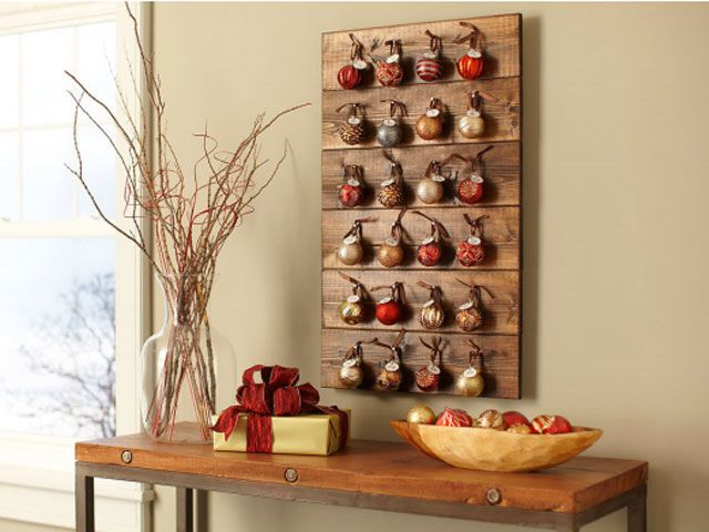 Use reclaimed wood, nails, and ornaments to make this rustic calendar. Get the tutorial at Home Depot.