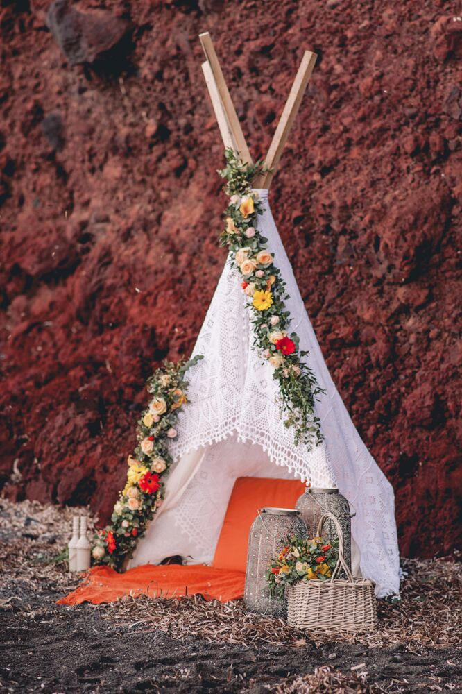 Colorful Bohemian Wedding Inspiration off the Coast of Santorini- floral teepee