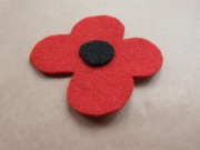 How to make a pinless poppy for Remembrance Day 2012 in 5 minutes or less!    http://quillandcurio.wordpress.com/2012/11/02/diy-5-minute-pinless-poppie-badges-and-wristlets/#