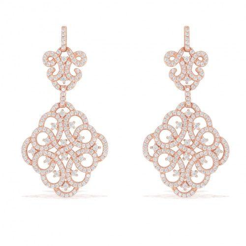 Somptueuses boucles pendantes en argent plaqué or rose incrustées d'oxydes blanc , motif arabesque , poussettes en silicone , 5 cm , peuvent se porter en parure avec le collier de la même ligne pour un effet étincellant .