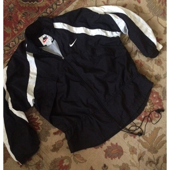 flash saleVintage Nike Windbreaker Coat very cool black and white Nike windbreaker jacket/coat. this is pretty lightweight for a coat but has a mesh lining that would be perfect for a milder day. black with white accents and Nike swoosh on chest. has a waist cincher but the elastic is very old. the zipper pull is missing but the zipper works. you just have to push/pull it with your hand Nike Jackets & Coats