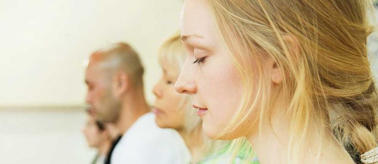 meditating people at guided meditation class