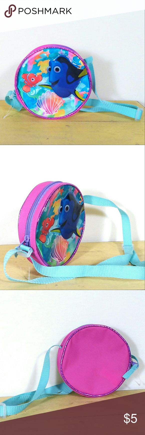"""Finding Dory circle purse shoulder bag Offers Are Awesome!! Bundles Make It Better! NWOT small circle shaped purse with 3D plastic front featuring Dory and Nemo from Disney Pixar Finding Dory movie. Pink base color, turquoise shoulder strap adjusts from 8-16"""". Polyester/nylon. Approx. 7"""" circumference with 2.5"""" interior width. #findingdory #findingnemo #girlspurse #disneybag #pixar Disney Accessories Bags"""