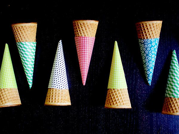 All it takes is origami paper, scissors and tape to make adorable ice cream cone sleeves