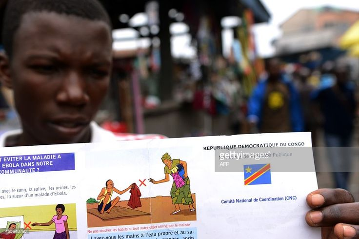 A man holds a Congolese Ministry of Health's information leaflet on Ebola virus on September 17, 2014