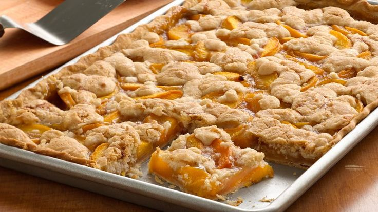 Serving a crowd? Treat your group of guests with this peach slab pie made using…