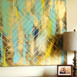 Great way of creating some inexpensive artwork for your home that is completely on trend #Gold #HomeCraft #WallArt #DuckTape
