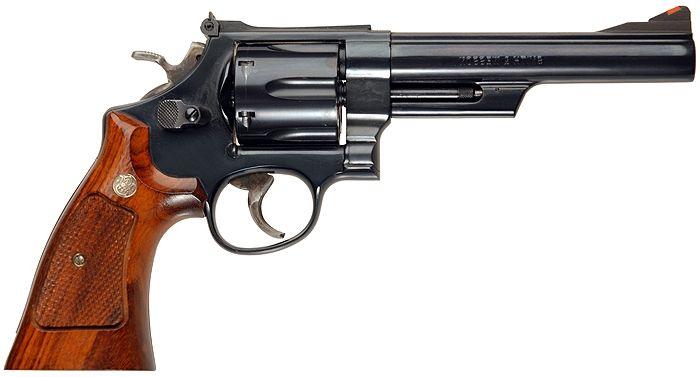 Smith & Wesson Model 29 / .44Magnum / 6 coups / Le Smith & Wesson Model 29 est un revolver en double action de calibre .44 Magnum, fabriqué à partir des années 1950 par la compagnie américaine Smith & Wesson.  Ce révolver a notamment été rendu célèbre par la série de films Inspecteur Harry, avec Clint Eastwood dans le rôle de Harry Callahan. Lors de sa sortie en 1955, cette arme avait pour qualificatif de « revolver le plus puissant du monde »
