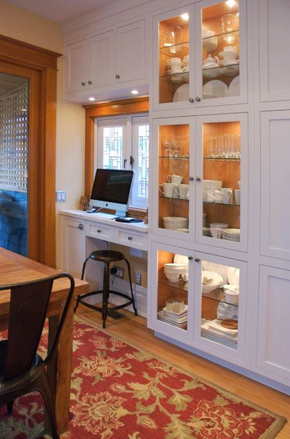 A Small Desk Space Is Tucked Into A Wall Of Dining Room