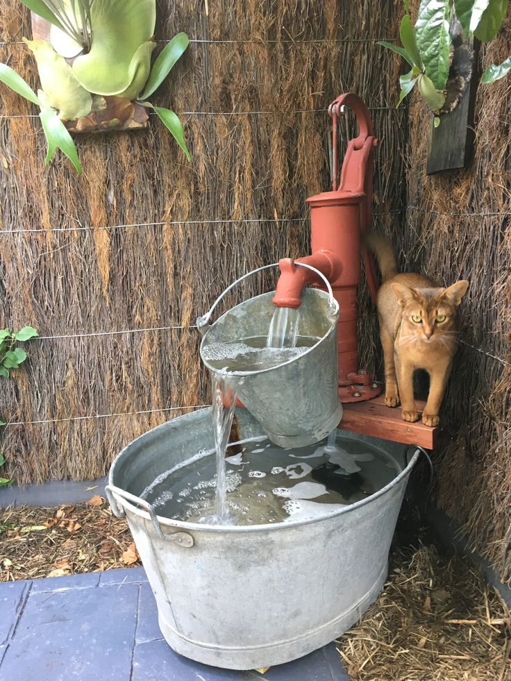 water fountain with old school water pump bucket and wash tub i will love this