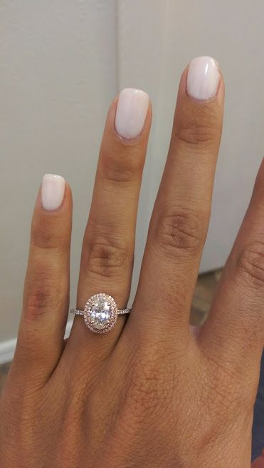white gold band, rose gold setting, oval stone, double halo