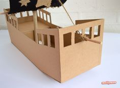 DIY cardboard pirate ship. Have fun and sail away with this whimsical project.