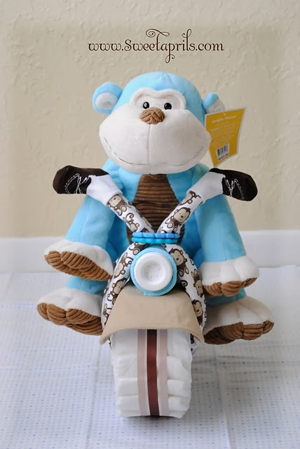 "diaper bike tutorial.  Made one for my sister.  I used a tube of diaper rash cream instead of a bottle for the ""headlight"""