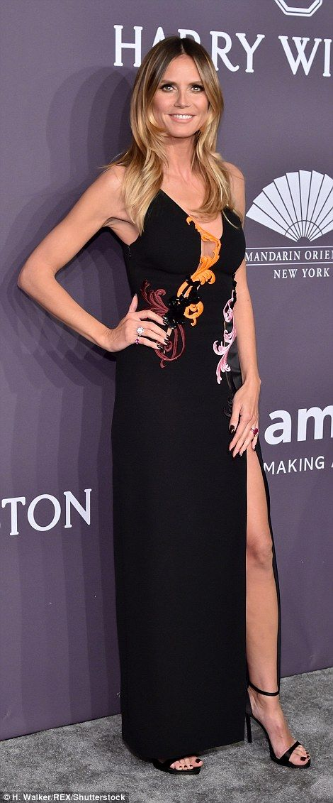 Stunning! Heidi proved her fashion veteran status as she wowed at the event in a slinky bl...