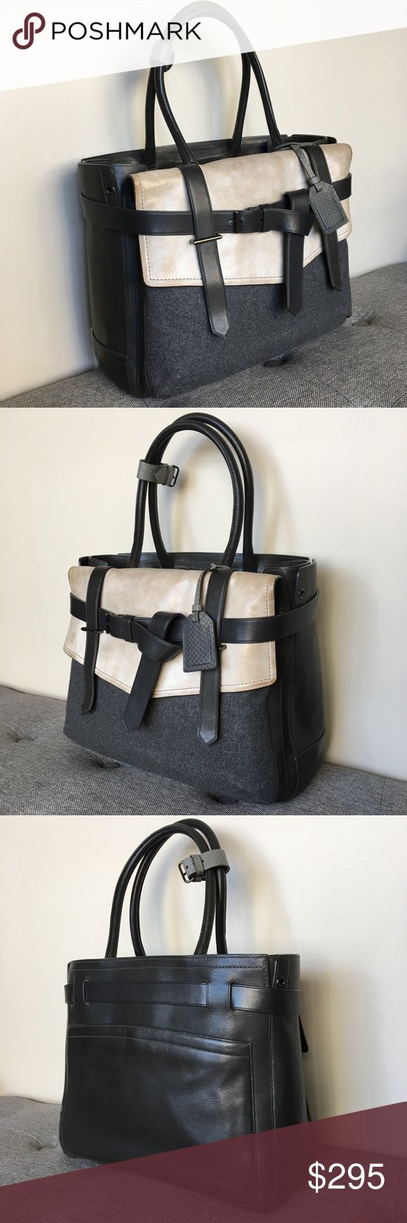 """Reed Krakoff Wool Black Leather Boxer Tote Handbag Original genuine leather Reed Krakoff """"Boxer"""" Handbag. Black smooth leather throughout, light gray leather front flap (color variation characteristic of the dye method) on a charcoal felted wool front pocket. The flap is lined in black leather. Gray snakeskin embossed strap belt and luggage tag accents. Lined in charcoal gray cloth. Measures 14"""" wide x 11"""" high x 5"""" deep, with a 8"""" dual strap drop. Overall excellent condition, with light…"""