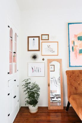 Homepolish Interior Design | Adding a standing mirror and unframed objects to the gallery wall mix adds a touch of play.