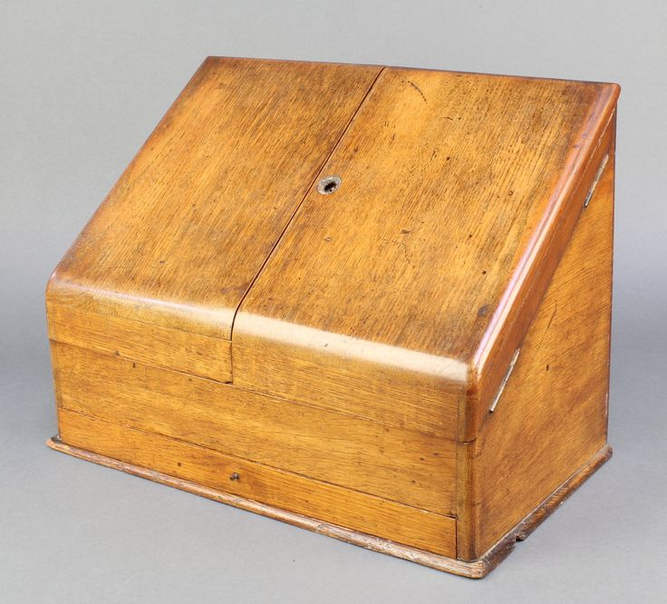 "Lot 964, A Victorian wedge shape light oak stationery box with hinged lid and fitted interior, the base fitted a drawer 11""h x 14 1/2""w x 8 1/2""d, est £50-75"
