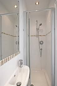 Narrow shower room mirror and tiles