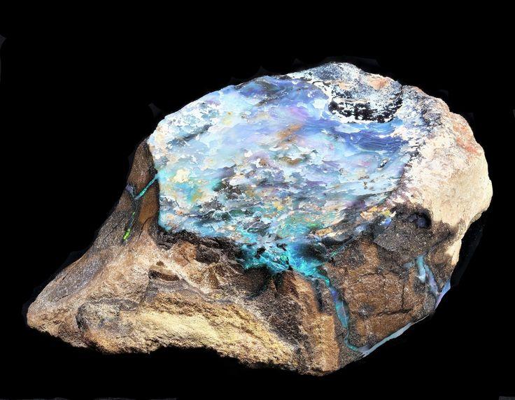 Black and boulder opal, Australia. Large gemmy patch 3cm.