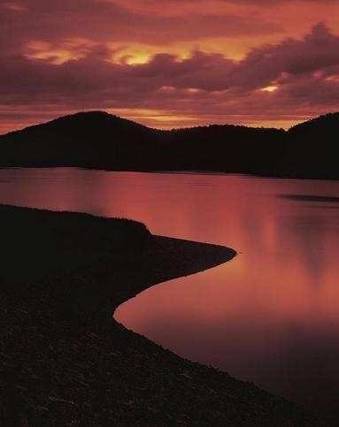 Fiery sunset over Broken Bow Lake at Beavers Bend State Park in southeast Oklahoma.