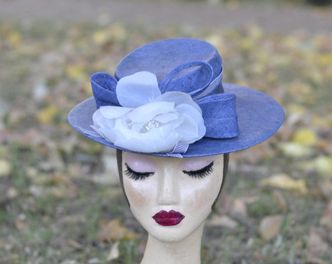 Cornflower blue boat with ribbon trim, bow, handmade white flower. Vintage style, races hat, wedding hat