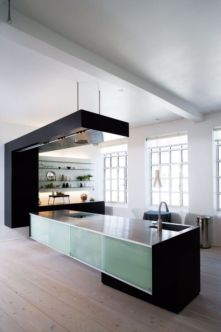 Fantastic floating kitchen from BoForm, custommade, with built-in light in the elements that makes them look even more floating.