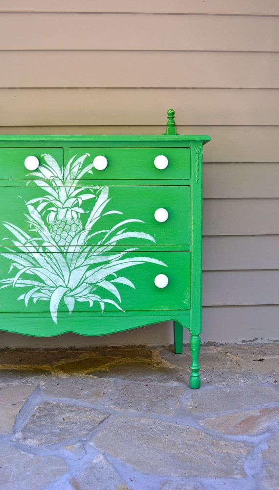 green painted dresser with Caribbean style pineapple design