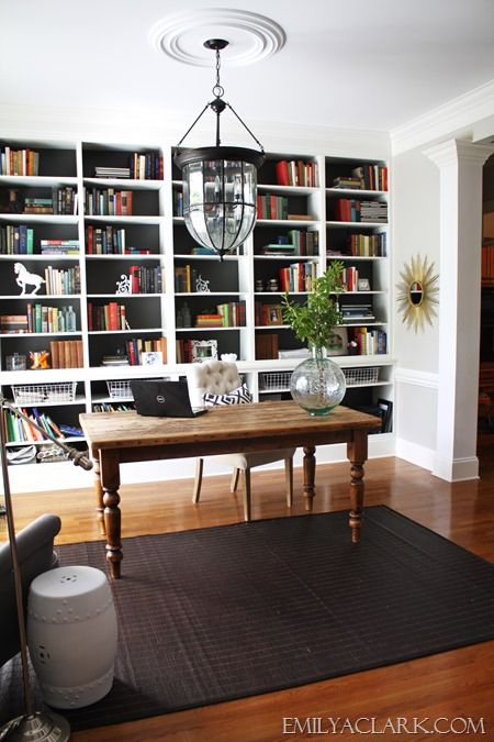 home office with built-in bookshelves - perfection  Yet another view of Emily Clark's great home office/dining room transformation.