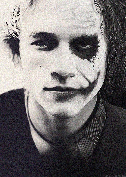 Heath Ledger with half of his joker makeup- I have an obsession...