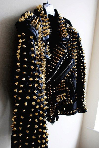 black leather jacket covered in fierce gold studs.