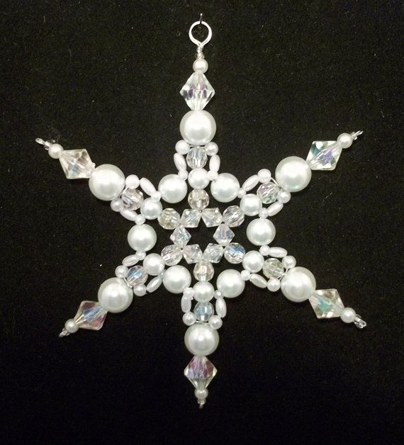 Snowflakes inspire these beaded ornament designs    White glass pearl beads, clear faceted AB round and bicone beads,  combined with white melon and