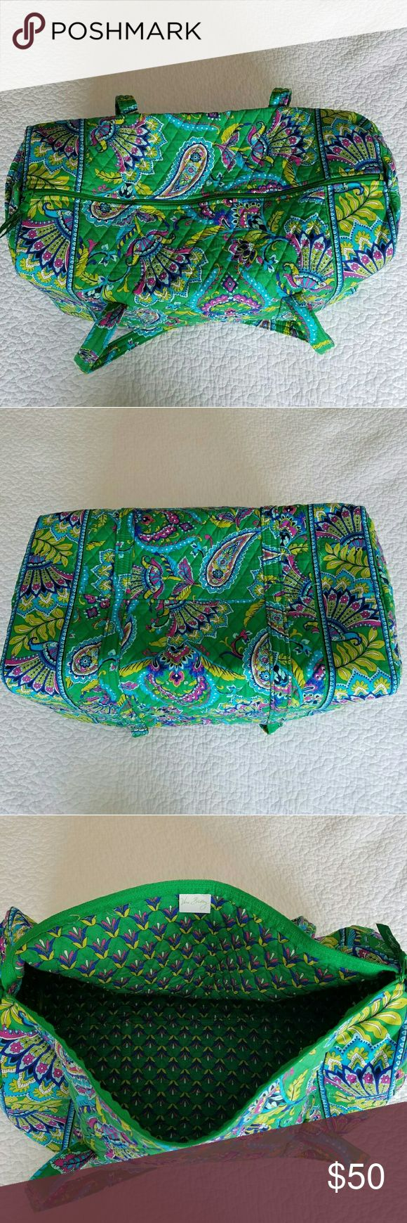 """**SOLD** Large Duffel Emerald Paisley Vera Bradley **SOLD**  Large Duffel in Emerald Paisley by Vera Bradley in excellent condition  Dimensions 22"""" W x 11.5"""" H x 11.5"""" D with 15"""" strap drop One outside end pocket  Purchased from Vera store several months ago. Used quite a but still in excellent condition. Fabric softened from slight use but otherwise like new. Fabric and lining show no fading, wear, marks, or stains inside or out.  Smoke free, cat friendly home. Please ask questions. Fair…"""
