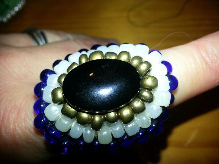 Black gold white and cobalt blue glass beads on crochet ring