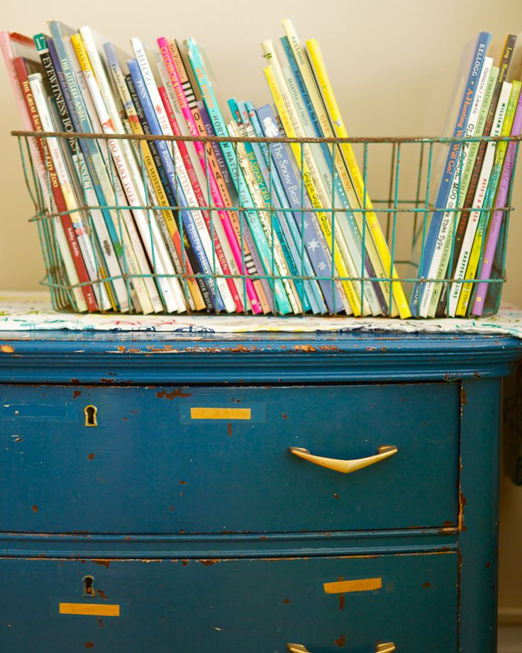 book storage idea.  I have that basket from my grandma, and have been trying to figure out the perfect use for it!