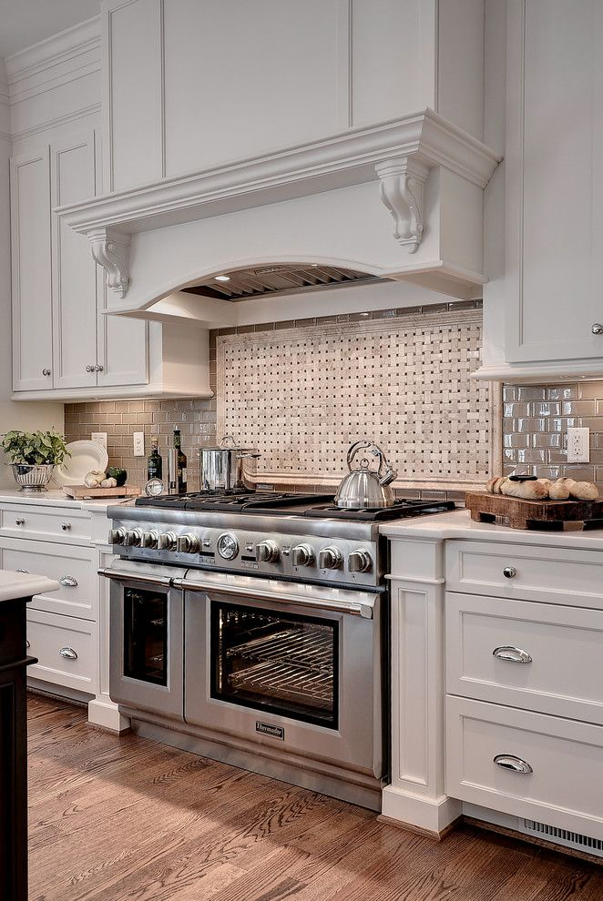 Cooking with Calphalon Kitchen Transitional with Chefs Kitchen Custom Hood Custom Ventilation Eat in Kitchen Gas Range Integrated Refrigeration