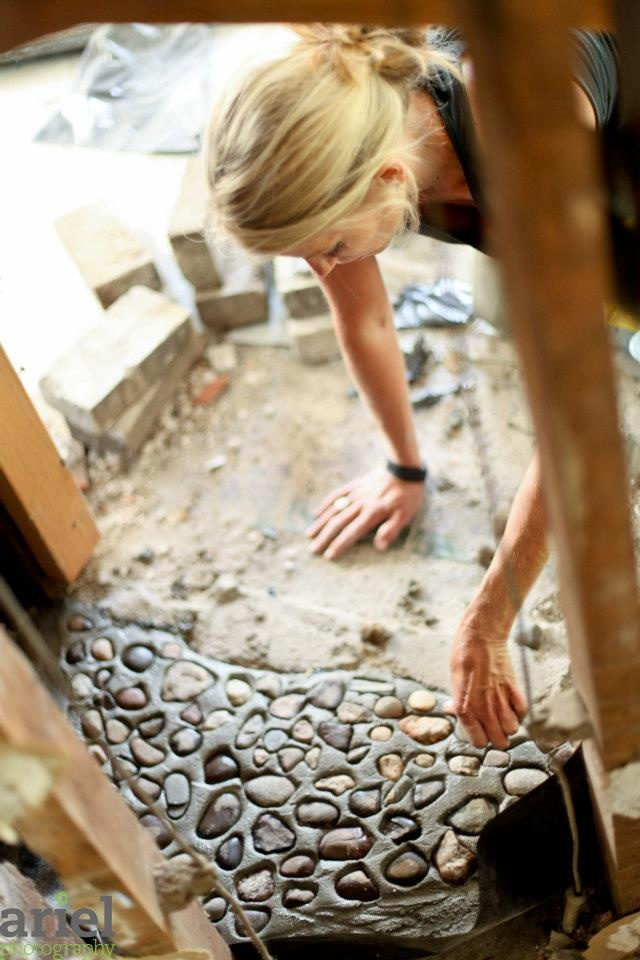 Nicole Curtis Rehab Addict -Dollar House-     Putting down river rock for fireplace #Fireplace #Ariel Photography