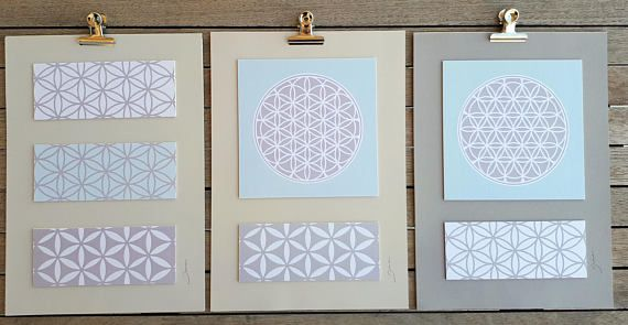 This Flower of life art design is an art print collage that will give an inspiring touch to any environment. This geometric paper wall art can be perfect as a hotel decoration, house decoration, spa decoration and yoga studio as a spiritual art. The design is inspired the sacred geometry symbol- Flower of life. The Flower of life is a geometric representation of the process of creation. Its energy will radiate through the room helping people to feel calm, relaxed and more peaceful…