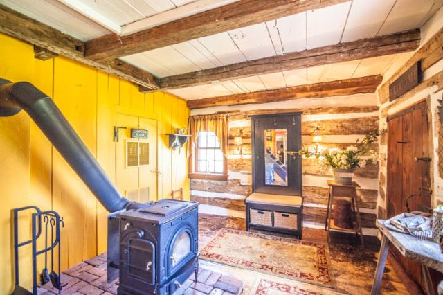 The Interior of This Adorable Log Cabin Is Surprisingly Bright and Cheerful  - CountryLiving.com