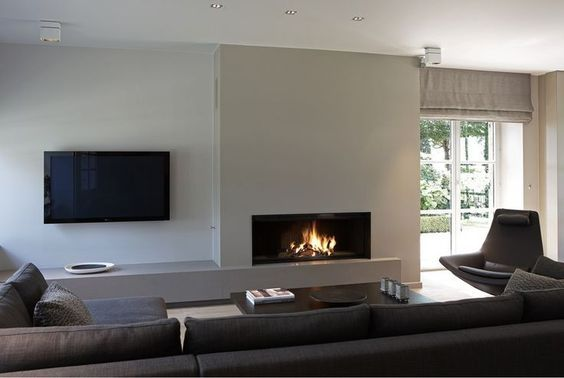 Modern luxury living room fireplace sectional minimal sophisticated interior design by Piet Boon