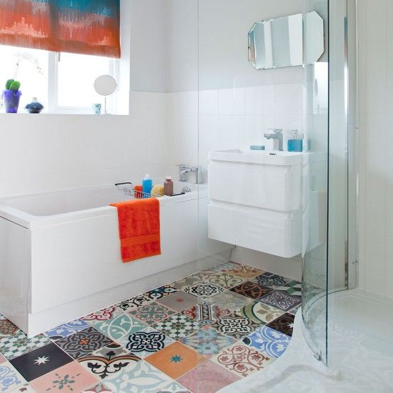 Bright white bathroom with colourful patterned tiles