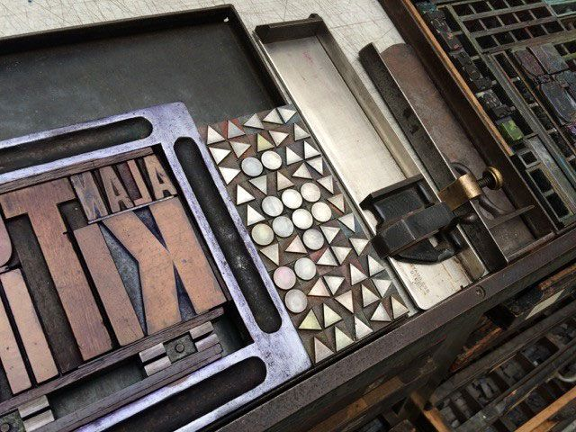"""Friday 22 April 12:00—15:00 Alan Kitching: A Life in Letterpress Alan Kitching hosts a live demo of his letterpress process in the gallery featuring a brand new print inspired by Somerset House's year of Utopia. Alan says of this work """"The print is based on the description in Thomas More's book of the 'Island of Utopia' incorporating my own version of the Utopian alphabet depicted in typographic ornaments of circle, square and triangle."""""""