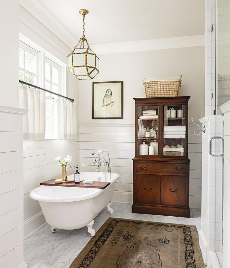 An antique china cabinet makes an unexpected statement in this beautiful bathroom  (: Lincoln Barbour) #homedecor #decorating