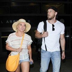 Hilary Duff arrives into LAX with boyfriend Jason Walsh
