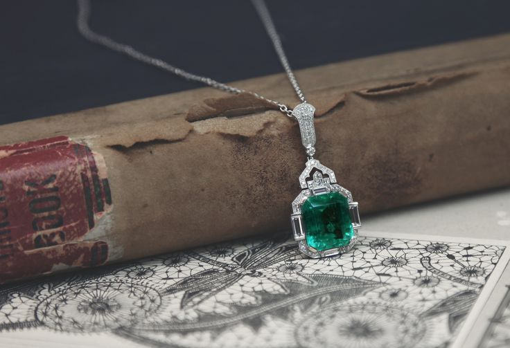 This Fairfax & Roberts handmade Art Deco pendant features a 19.77ct natural Colombian Emerald.  Read our latest blog post about Emeralds - The Birthstone of May.