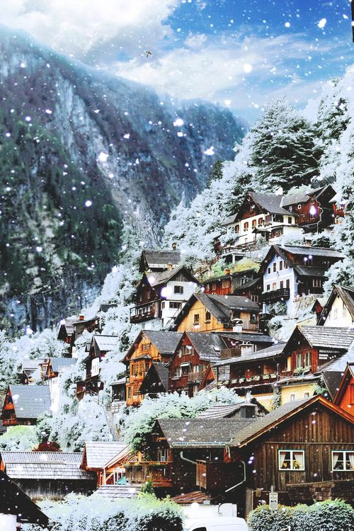 From a fairytale, the old village of Hallstatt, Austria on a snowy day.