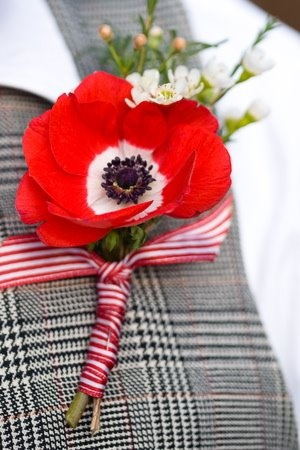 red boutonnieres poppy - could be used as a remembrance or to honor, remember a lost one in a wedding