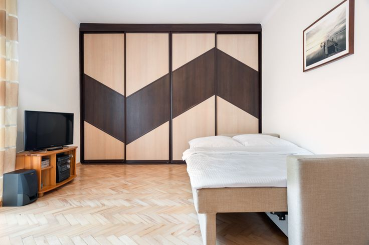Cracoff   Chocimska 24 modern extra large closet, comfy sofa bed