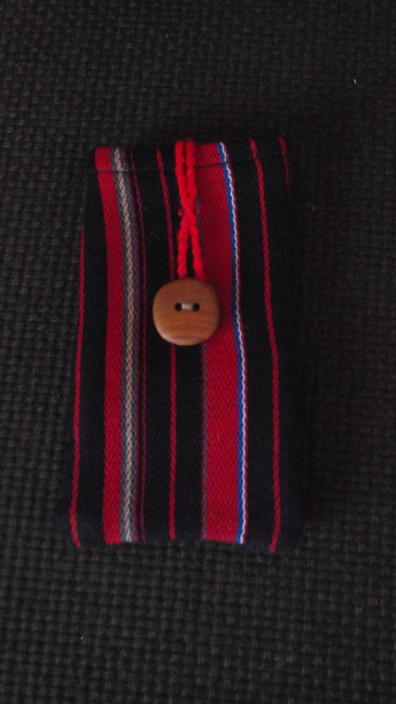 Mobile phone pocket made out of Finnish folk costume materials.  @http://www.facebook.com/Kansanomaisetkankaat